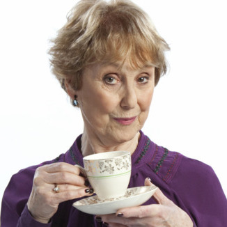 Mrs. Hudson with a cup of tea.